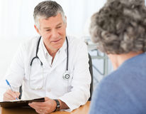 A senior doctor talking with his patient Stock Image