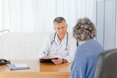 A senior doctor talking with his patient Stock Photo
