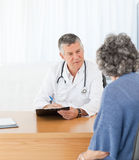 A senior doctor talking with his patient Royalty Free Stock Image