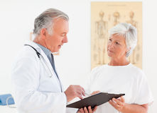 Senior doctor talking with his sick patient Stock Photo