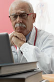 Senior Doctor Using Webcam Stock Image