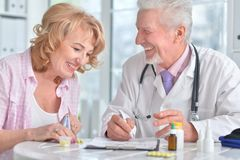 Senior Doctor With Elderly Patient Royalty Free Stock Image