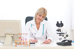 Senior doctor woman working at office Stock Photography