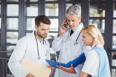 Senior doctor working with coworkers Stock Image