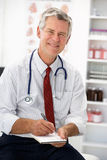 Senior doctor writing prescription Stock Photos