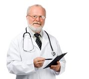 Senior doctor writing reports. Portrait of a senior doctor writing reports isolated over white background Stock Photography