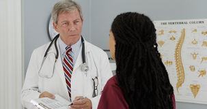 Senior doctor and Young nurse discussing patient's results Stock Photo