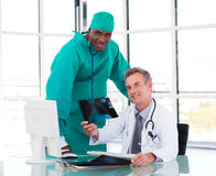 Senior doctor and young surgeon studying an X-ray Stock Photos