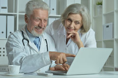 Senior Doctors   with laptop Stock Photos