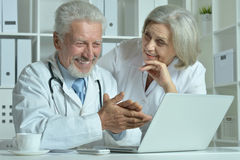 Senior Doctors   with laptop Royalty Free Stock Photography