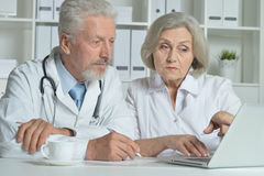 Senior Doctors   with laptop Stock Photo