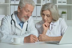 Senior Doctors   with laptop Royalty Free Stock Image