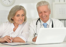 Senior Doctors   with laptop Stock Photography