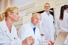 Senior doctors in meeting. With young trainees royalty free stock photography