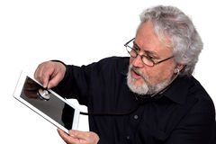 Senior is doing tablet pc diagnosis Stock Photo