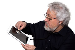 Senior is doing tablet pc diagnosis Stock Photos
