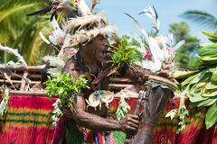 Senior doing impressive dragon dance ceremony, Kopar village, Sepik River, Papua New Guinea