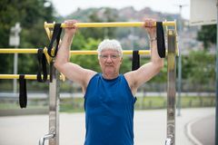 Senior doing physical activity. Senior doing bar as physical activity Royalty Free Stock Photography
