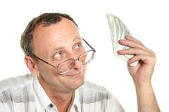 Senior with dollars Stock Photo