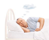 Senior dreaming with cloud above head Stock Images