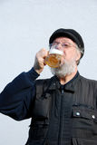 Senior drinking beer Stock Image