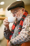 Senior Drinking Coffee. Senior man resting and drinking coffee Stock Images