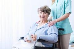 Senior drinking tea for indigestion. Image of senior women drinking tea for indigestion Stock Photography