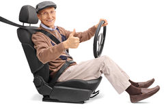 Senior driving and giving a thumb up royalty free stock images