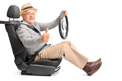 Senior driving and giving a thumb up Stock Images