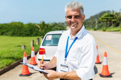 senior driving instructor writing royalty free stock images