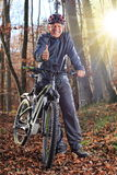 Senior with e-bike MTB and thumb up Stock Images