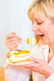Senior eating cake in the afternoon Stock Image
