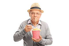 Senior eating Chinese noodles from a paper box Royalty Free Stock Image
