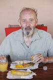Senior eating healthy meal in residential care home Royalty Free Stock Photo