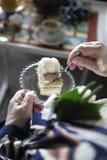 Senior eating a piece of cake Royalty Free Stock Image