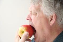 Senior eats apple Stock Photos