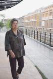 Senior elder walking on balcony looking at the city view, elderl Royalty Free Stock Image