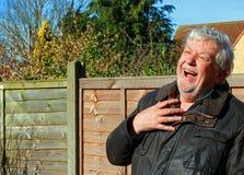 Senior or elderly man laughing. Royalty Free Stock Photography