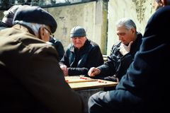 senior elderly man playing backgammon in a public park royalty free stock photo