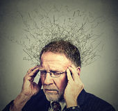 Senior elderly man with worried stressed face expression looking down Stock Photos