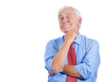 Senior elderly mature man daydreaming about something that makes him happy Stock Photos