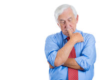 Senior elderly mature man trying to remember something in deep thought and worried. Closeup portrait of senior elderly mature man trying to remember something in Royalty Free Stock Image