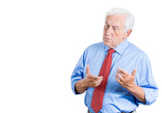 senior elderly mature man trying to remember something, but forgetting Stock Photography