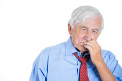 Senior elderly mature man with white hair really sad and in deep thought Stock Images