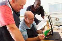Senior electrical technicians Stock Photos