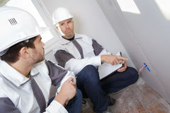 Senior electrician pointing at cable Stock Photo