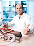 Senior electronics repairman Royalty Free Stock Image