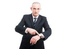 Senior elegant man showing time on wrist watch Royalty Free Stock Image