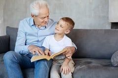 Senior emotional man enjoying his grandsons company stock images