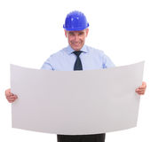 Senior engineer holding a spread project and smiling Royalty Free Stock Photography